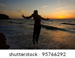silhouette of a man jumping at... | Shutterstock . vector #95766292