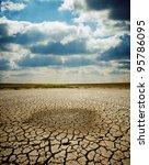 last wet spot in cracked earth... | Shutterstock . vector #95786095