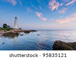 Lighthouse At Dusk Sunset At...