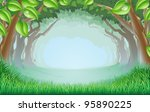 A beautiful woodland scene with trees and grass and space in the centre - stock photo