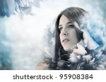 Beautiful girl with elegant blue flower background - stock photo