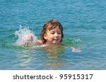 happy child swims in sea.... | Shutterstock . vector #95915317