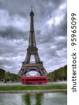 dark scene of Eiffel tower in Paris, France and red bus - stock photo