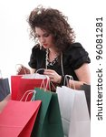 lovely woman with shopping bags over white - stock photo