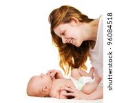 Happy smiling mother playing with her baby - stock photo