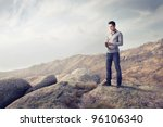 young man in the mountains...   Shutterstock . vector #96106340