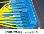 network cables and servers in a technology data cente - stock photo