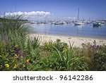"""""""Seaport View Martha's Vineyard"""" A garden view of a marina on Martha's Vineyard on a nice Summer day. - stock photo"""