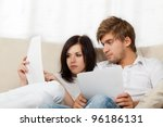 unhappy couple reading a letter ... | Shutterstock . vector #96186131
