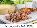 Peking Duck - Chinese roast duck served with pancakes, cucumber and  spring onions. - stock photo