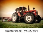 Old Tractor On The Grass Field