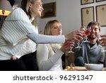 Friends Drinking Wine At Party