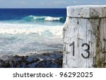 Stock photo mooring post or bollard in front of deep blue ocean and waves 96292025