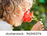 Child With Rose Flower In...