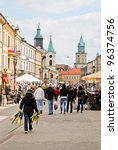 LUBLIN, POLAND – APRIL 15: The central pedestrian street of Lublin on April 15, 2011 in Lublin, Poland. Lublin is a candidate for the title of European Capital of Culture in 2016. - stock photo