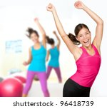 Fitness dance class aerobics. Women dancing happy energetic in gym fitness class.