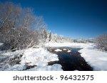 Stream In Snowy Field.