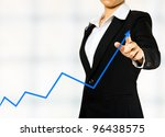 business woman drawing a graph - stock photo