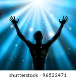 A man with hands held up in silhouette with light rays in the background - stock photo