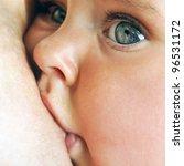 Mother Breastfeeding Her Baby...