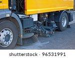 Street Sweeper Cleans Street...
