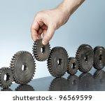 Man Adding A Cog Gear In A Row...