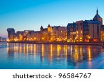 Old town in Gdansk with frozen Motlawa river at dusk, Poland - stock photo