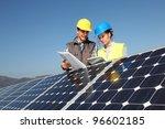 man showing solar panels...