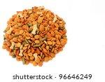Pile of dog food bits on white background - stock photo