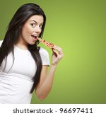 young woman eating a piece of... | Shutterstock . vector #96697411