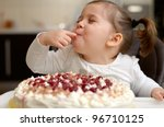 Cute Little Girl Eating Cake
