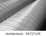 Close up of shiny metal pipes with diminishing perspective - stock photo