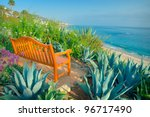 A Wooden Bench Overlooking The...