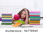 Young girl tired learning laying among lots of books - stock photo