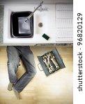Plumber Under Kitchen Sink Wit...