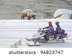 Two Snowmobilers View A Bison...