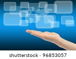 Woman hand with touch screen interface and world map on background - stock photo