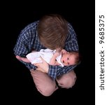father and newborn on the black ... | Shutterstock . vector #9685375