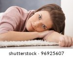 daydreaming young woman lying... | Shutterstock . vector #96925607