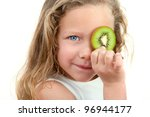 Close up Portrait of cute little girl holding fruit in front of eye. Isolated on white background. - stock photo