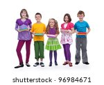Group of happy kids preparing for school - holding their books - stock photo