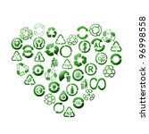 Assorted green recycle pictograms arranged into heart shape over white background - stock photo