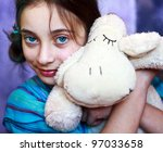 A Young Girl Squeezing Hugging...
