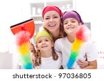 Cleaning task-force - woman with kids holding utensils - stock photo
