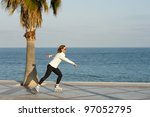 skating along a beach promenade ...   Shutterstock . vector #97052795