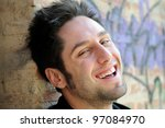 Portrait of happy man in urban background - stock photo