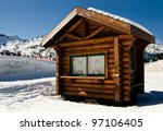 Small Wooden Cabin With Two...