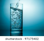 studio shot of pouring water in ... | Shutterstock . vector #97175402