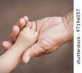 holding baby hand | Shutterstock . vector #97196057