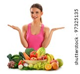 Young caucasian woman with variety of fresh raw vegetables and fruits isolated on white - stock photo